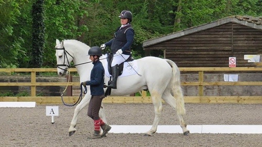 Sallyann Haigh intermittent catheter user riding horse after spinal cord injury